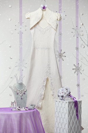 bridal gown: Beautiful felted bridal gown together with wedding acccessories over snowy background