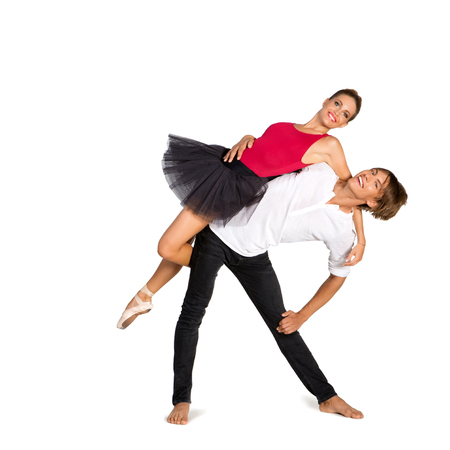 tout: Beautiful young couple dancing ballet over white background Stock Photo