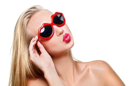 kissing mouth: Beautiful young woman in lips shaped red sunglasses. Kissing mouth. Isolated over white background.