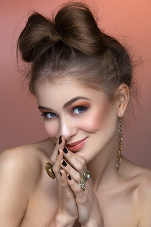 hair bow: Beautiful young woman with hair bow and rings. Beauty shot. Copy space.