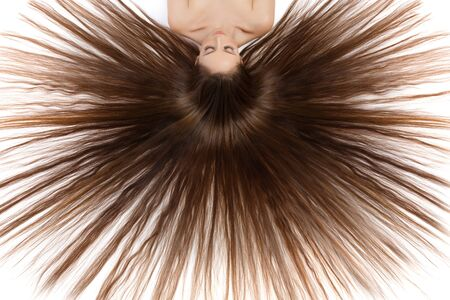 silky hair: Beautiful happy young woman with long silky brown hair Stock Photo