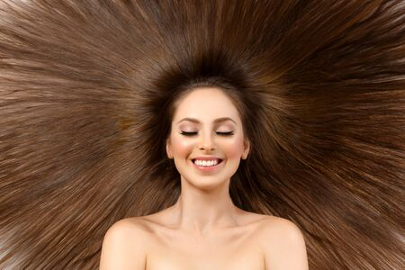 long silky hair: Beautiful happy young woman with long silky brown hair Stock Photo