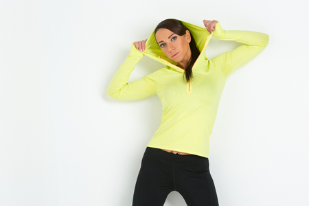 sportwear: Beautiful sporty fit young woman in green and black sportwear. Isolated over white background. Stock Photo