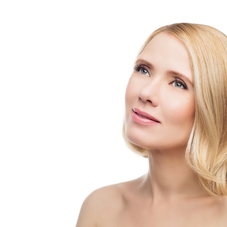 natural looking: Beautiful middle aged woman with smooth skin and short blond hair. Beauty shot. Isolated over white background. Copy space.