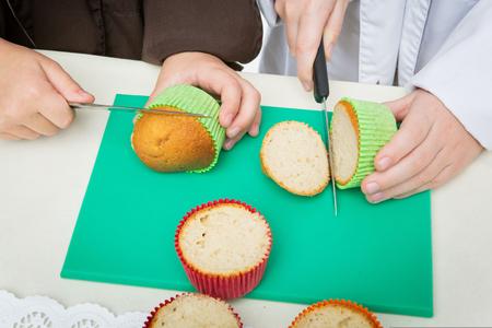 christmas cupcakes: Children hands making christmas cupcakes. Preparation process.