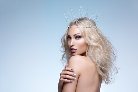 Beautiful young woman with crown. Cold tones. Copy space. Stock Photo