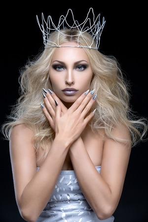silver hair: Beautiful young woman with crown. Cold tones. Copy space. Stock Photo