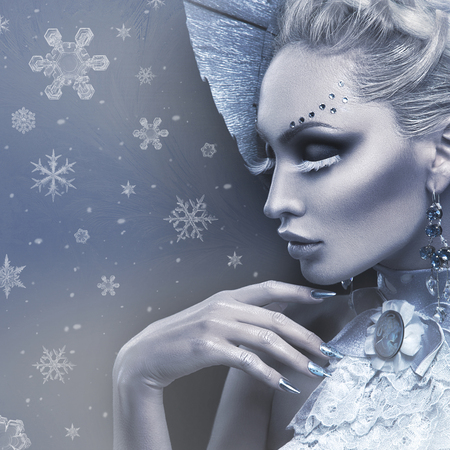 Closeup portrait of beautiful young woman dressed as winter queen. Creative makeup. Over black background. Copy space. Standard-Bild