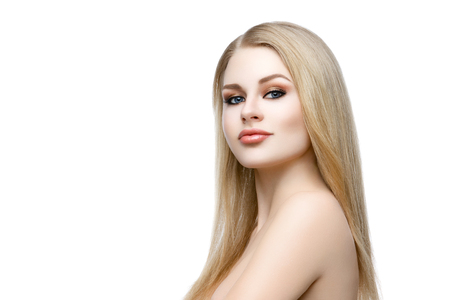 Closeup portrait of beautiful young woman with messy long blond hair and bright makeup. Beauty shot. Isolated over white background. Copy space. Stock Photo