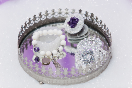 bijoux: Beautiful set of bridal accessories made from natural stones. Rock crystal and agate ring and earrings. Copy space.