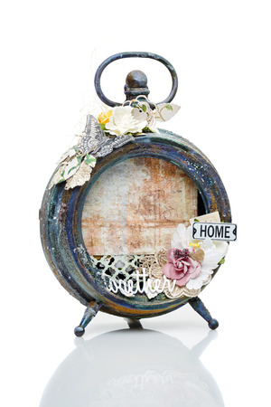 Beautiful handmade photo frame with paper details made from vintage alarm clock. Scrapbooking. Isolated on white. Copy space. Stock fotó