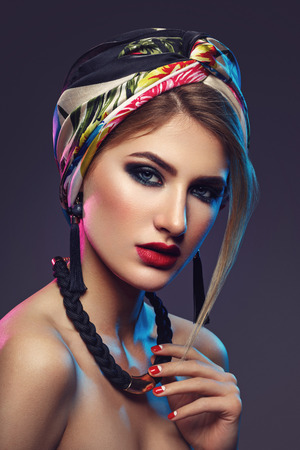 Beautiful girl with bright make-up and shawl on head Stock Photo
