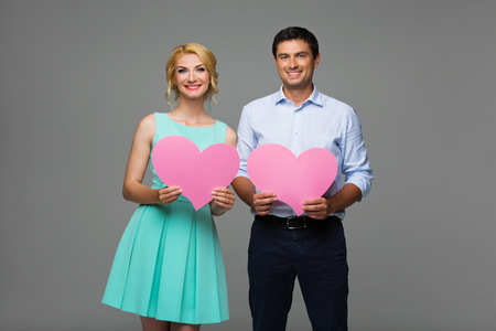 pink hearts: Beautiful couple holding pink hearts