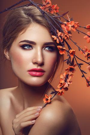 Beautiful girl with sakura branch Standard-Bild