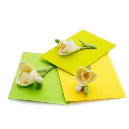 Close up of three yellow envelope with flowers