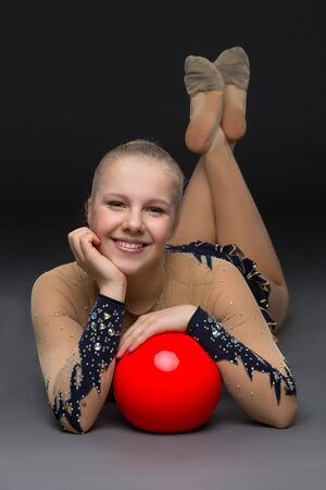 an entertainer: Gymnastist girl with red ball