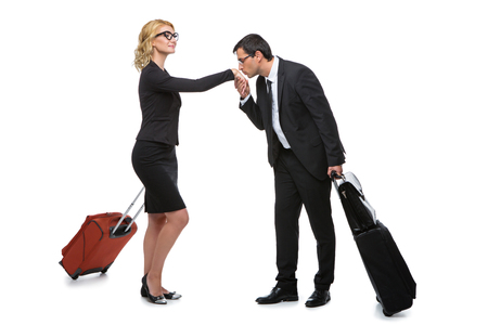 Businessman and business woman with travel cases