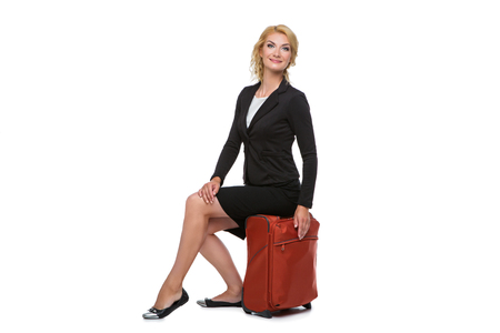 business woman sitting on travel case
