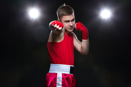 Young boxer in red form