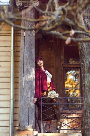 Girl standing on old house balcony Stock Photo