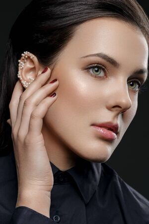 Beautiful girl with pearls on ear Stock Photo
