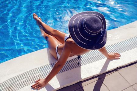 Beautiful girl in outdoor pool Фото со стока