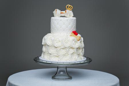 beautiful traditional white wedding cake with bone decor for dog wedding party. studio shot. copy space.