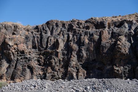 ocean volcanic rock with sihuette of angel near adeje on tenerife island. outdoor shot.