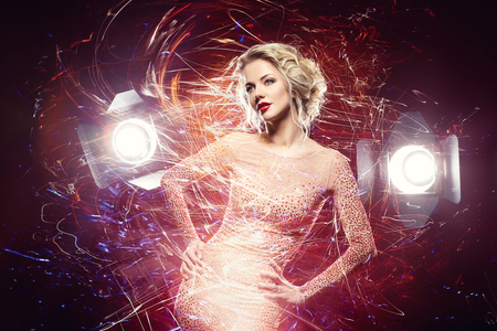 beautiful girl in evening dress surrounded by light Stock Photo