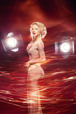 beautiful girl in evening dress surrounded by light 写真素材