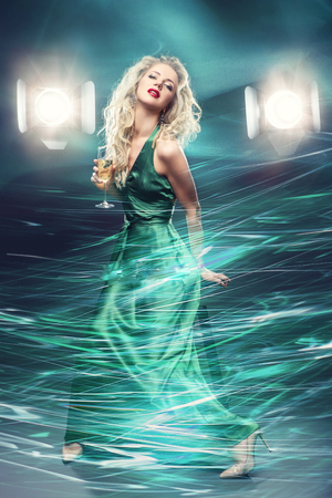 beautiful girl in evening dress surrounded by light 스톡 콘텐츠