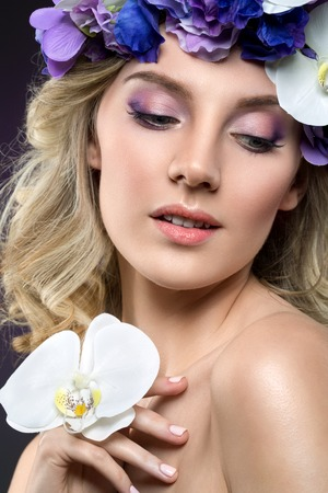 beautiful blond girl with flowers Stock Photo
