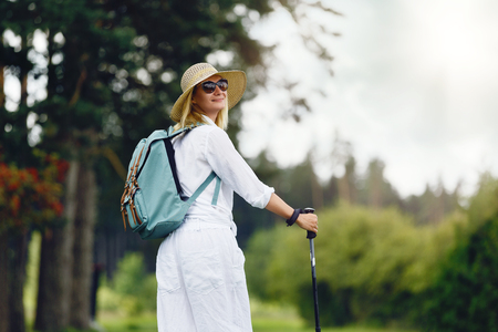 young woman with nordic walk pols Stock fotó