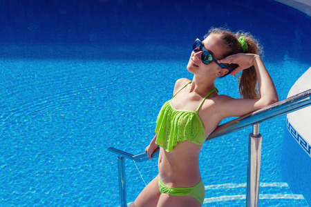teen girl relaxing near swimming pool