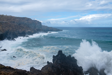 natural ocean swimming pools on Tenerife island while stormy weather. outdoor shot in Spain. copy space.
