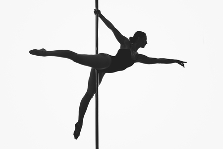 beautiful pole dancer girl silhouette 写真素材