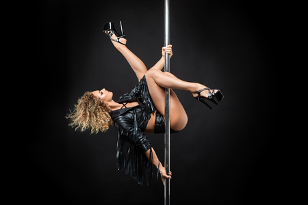beautiful pole dancer in leather jacket on pylon