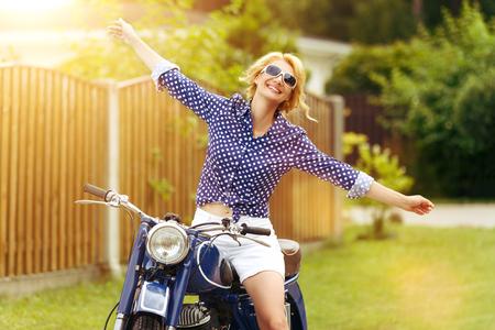 beautiful girl on retro motorbike