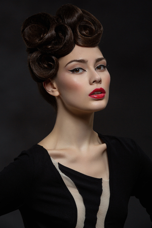 beautiful young woman with fancy hairdo and red lips Stock Photo