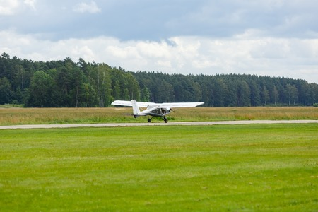 outdoor shot of small plane taking off