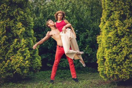 beautiful modern ballet couple dancing in summer outdoors