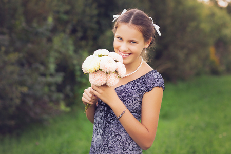 beautiful teen age girl holding flowers