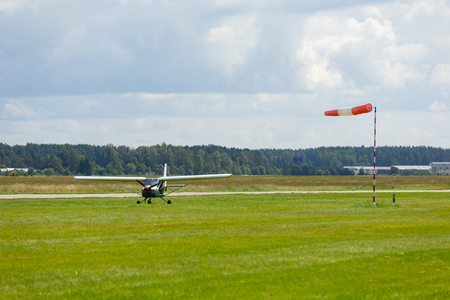 small plane on green field before take-off outdoors
