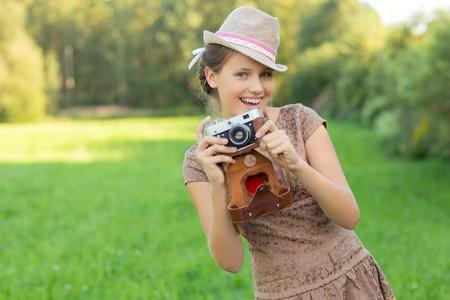 beautiful teen age girl with retro camera