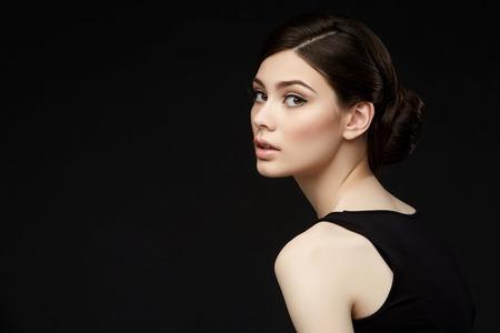 beautiful girl with hairdo on balck background Stock Photo