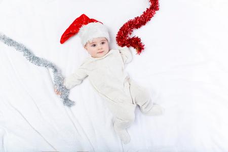 beautiful baby boy in christmas hat lying