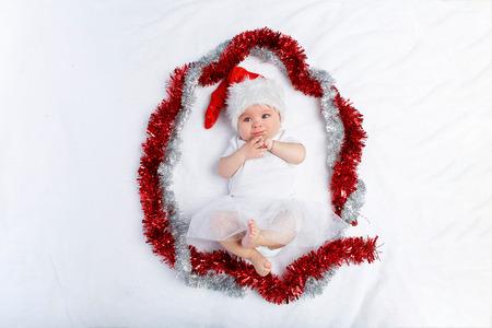 beautiful baby girl in christmas hat lying