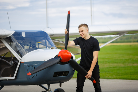 young man in small plane cockpit