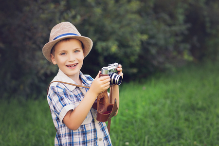 handsome little boy with retro camera