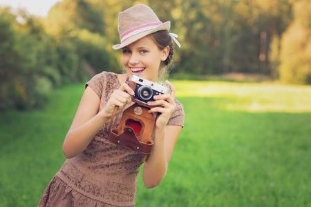 beautiful teenage girl with retro camera